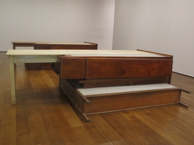 """Untitled"" (2008), by Doris Salcedo. wooden tables, wooden armoires, metal, concrete. Harvard Art Museums, Cambridge, MA."