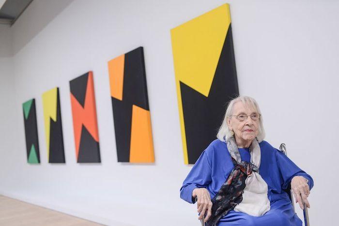 Carmen Herrera at her retrospective, Whitney Museum of American Art, New York.  Source:  http://artishockrevista.com/2016/11/28/carmen-herrera-reconocida-gran-retrospectiva-whitney/