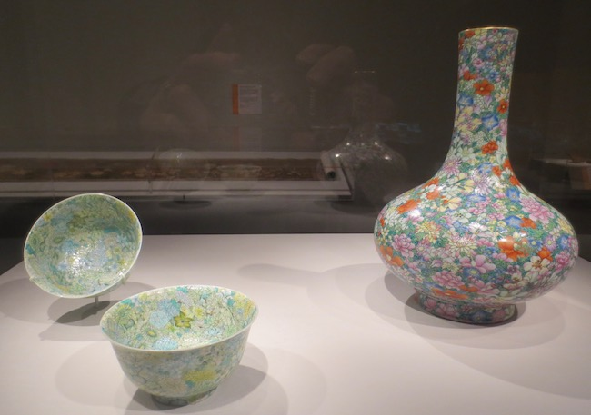 "Vase and pair of bowls with ""one hundred flowers"" motif. Porcelain with overglaze enamels. China, Jingdezhen, Jiangxi province, Qing dynasty (1736-1820). Asian Art Museum, San Francisco."