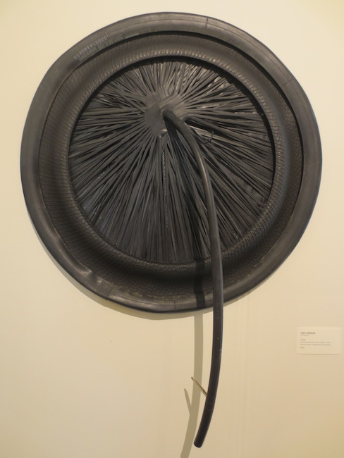 """Tube,"" by Leah Cabinum. Up-cycled inner tube rubber, wire, wood, paint, hardware, and tire parts. Marin MOCA."