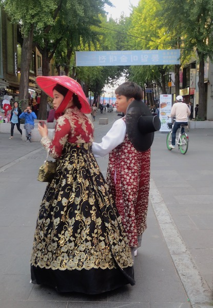 Dressed in rented  hanbok , a young couple stroll through Insadong in Seoul.