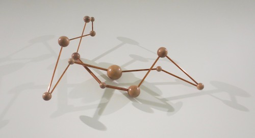 """Reclining Molecule"" (2013), by P. Koshland. Wooden balls and metal rods. BAMPFA."