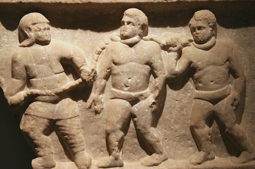 Roman collared slaves in a marble frieze from Smyrna (Izmir, Turkey), 200 C.E. Ashmolean Museum, Oxford, England. Source: commons.wikimedia.org/.