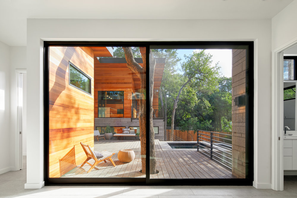 16-Ridgewood Residence by Matt Fajkus Architecture. Photo by Leonid Furmansky.jpg