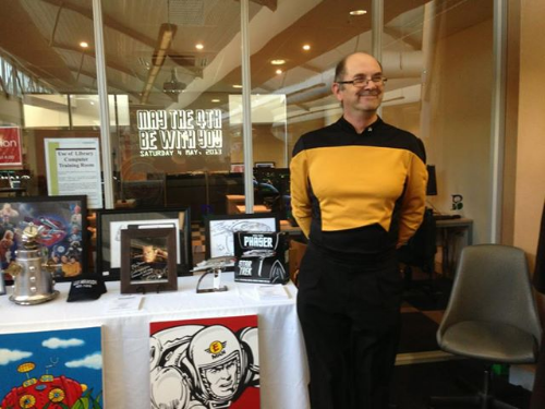 One of our members - Roy, enjoying our pop culture expo and what colourful memorabilia on display next to him!