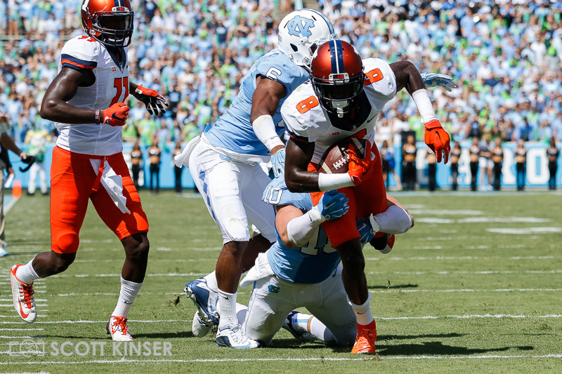 September 19, 2015: Geronimo Allison (8) of the Illinois Fighting Illini gets tied up after the catch in the NCAA football matchup between the Fighting Illini of Illinois and the North Carolina Tarheels at Kenan Memorial Stadium in Chapel Hill, NC. Scott Kinser/CSM