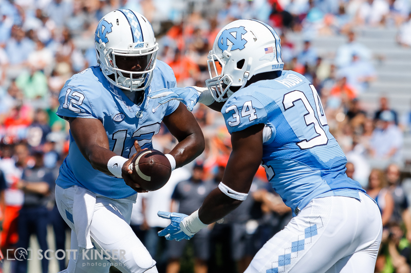September 19, 2015: Marquise Williams (12) of the North Carolina Tar Heels hands of to Elijah Hood (34) of the North Carolina Tar Heels during the NCAA football matchup between the Fighting Illini of Illinois and the North Carolina Tarheels at Kenan Memorial Stadium in Chapel Hill, NC. Scott Kinser/CSM
