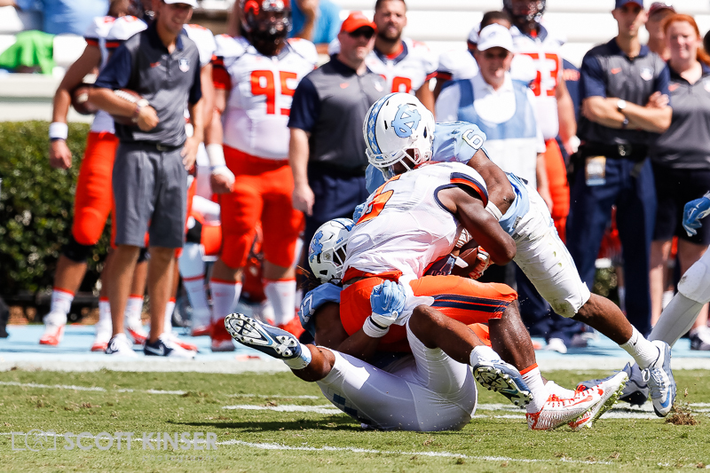 September 19, 2015: Josh Ferguson (6) of the Illinois Fighting Illini gets dragged down by Dajaun Drennon (17) of the North Carolina Tar Heels for a big loss in the NCAA football matchup between the Fighting Illini of Illinois and the North Carolina Tarheels at Kenan Memorial Stadium in Chapel Hill, NC. Scott Kinser/CSM