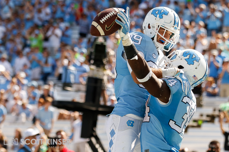 September 19, 2015: Thomas Brown (29) of the North Carolina Tar Heels congratulates teammate Elijah Hood (34) of the North Carolina Tar Heels after his touchdown in the fourth quarter of the NCAA football matchup between the Fighting Illini of Illinois and the North Carolina Tarheels at Kenan Memorial Stadium in Chapel Hill, NC. Scott Kinser/CSM