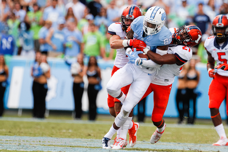 September 19, 2015: Bug Howard (84) of the North Carolina Tar Heels Drags two defender with him for the big gain in the NCAA football matchup between the Fighting Illini of Illinois and the North Carolina Tarheels at Kenan Memorial Stadium in Chapel Hill, NC. Scott Kinser/CSM