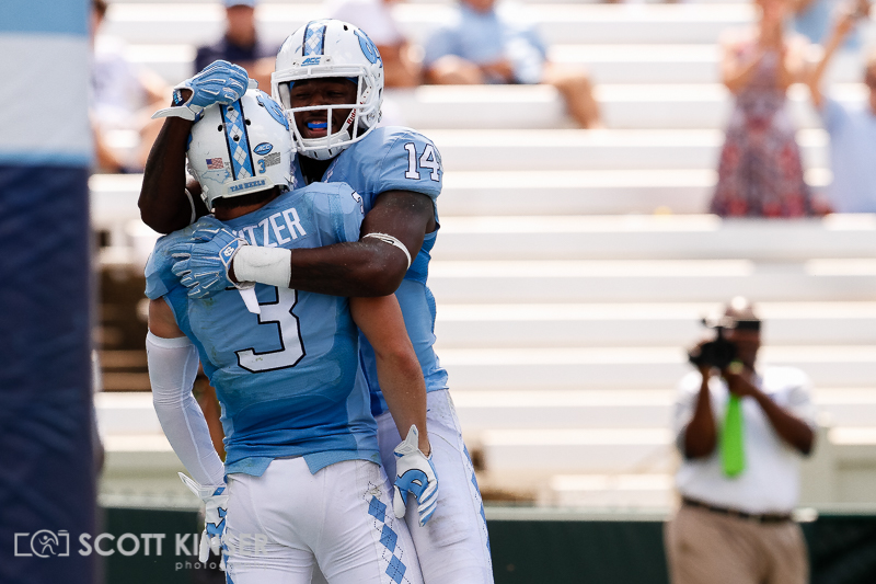September 19, 2015: Ryan Switzer (3) of the North Carolina Tar Heels celebrates with Quinshad Davis (14) of the North Carolina Tar Heels after his first touchdown of the day in the NCAA football matchup between the Fighting Illini of Illinois and the North Carolina Tarheels at Kenan Memorial Stadium in Chapel Hill, NC. Scott Kinser/CSM