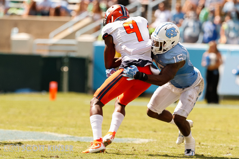 September 19, 2015: Sam Mays (9) of the Illinois Fighting Illini gets wrapped up by Donnie Miles (15) of the North Carolina Tar Heels in the NCAA football matchup between the Fighting Illini of Illinois and the North Carolina Tarheels at Kenan Memorial Stadium in Chapel Hill, NC. Scott Kinser/CSM