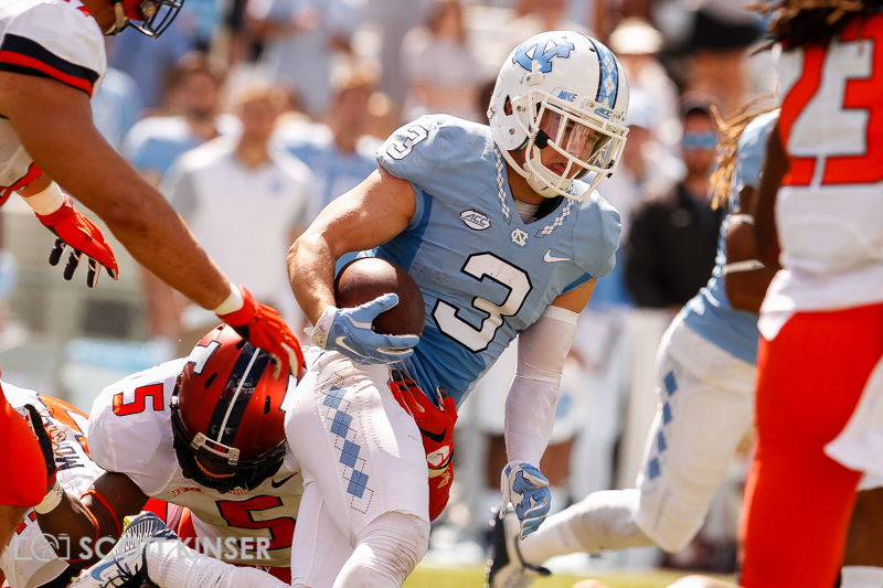 September 19, 2015: Ryan Switzer (3) of the North Carolina Tar Heels gets tied up on this punt return by James Crawford (5) of the Illinois Fighting Illini in the NCAA football matchup between the Fighting Illini of Illinois and the North Carolina Tarheels at Kenan Memorial Stadium in Chapel Hill, NC. Scott Kinser/CSM
