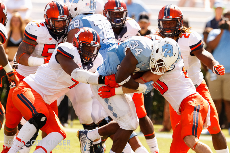 September 19, 2015: Elijah Hood (34) of the North Carolina Tar Heels gets wrapped up by two illini defenders in the NCAA football matchup between the Fighting Illini of Illinois and the North Carolina Tarheels at Kenan Memorial Stadium in Chapel Hill, NC. Scott Kinser/CSM