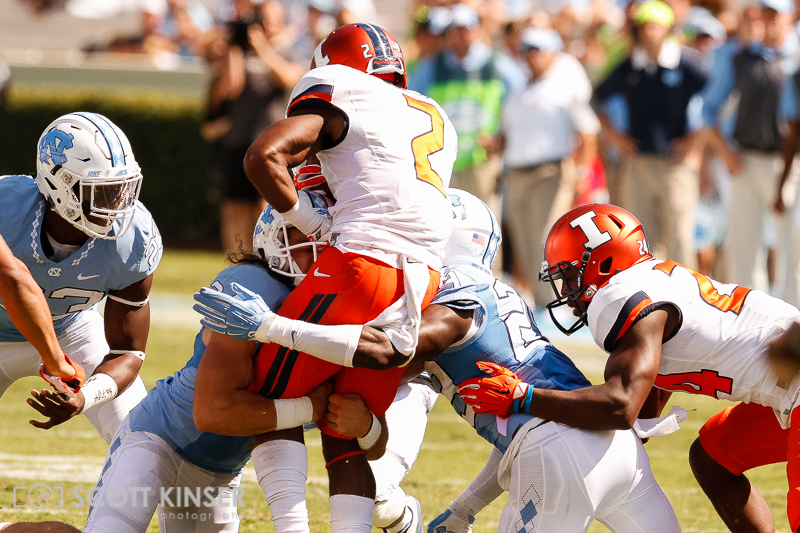 September 19, 2015: Reggie Corbin (2) of the Illinois Fighting Illini runs into Ayden Bonilla (24) of the North Carolina Tar Heels in the NCAA football matchup between the Fighting Illini of Illinois and the North Carolina Tarheels at Kenan Memorial Stadium in Chapel Hill, NC. Scott Kinser/CSM