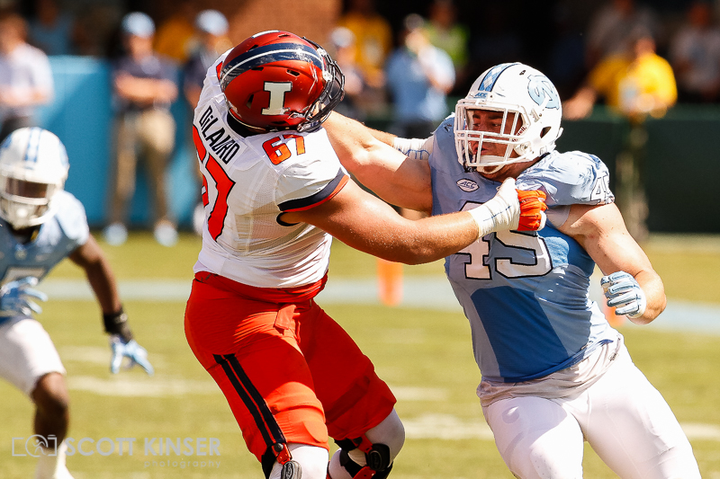 September 19, 2015: Jeremiah Clarke (49) of the North Carolina Tar Heels battles with Christian DiLauro (67) of the Illinois Fighting Illini in the NCAA football matchup between the Fighting Illini of Illinois and the North Carolina Tarheels at Kenan Memorial Stadium in Chapel Hill, NC. Scott Kinser/CSM