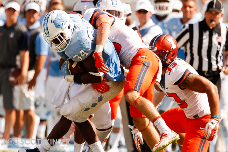 September 19, 2015: Elijah Hood (34) of the North Carolina Tar Heels gets wrapped up in the NCAA football matchup between the Fighting Illini of Illinois and the North Carolina Tarheels at Kenan Memorial Stadium in Chapel Hill, NC. Scott Kinser/CSM
