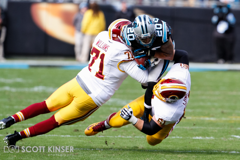 November 22, 2015: Kurt Coleman (20) of the Carolina Panthers gets taken down after his interception by Trent Williams (71) and Spencer Long (61) of the Washington Redskins in the first quarter of the NFL Football match-up between the Washington Redskins and the Carolina Panthers at Bank of America Stadium in Charlotte, NC. Scott Kinser/CSM