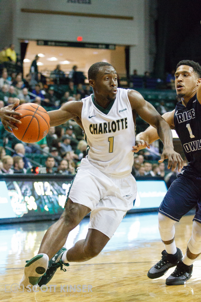 February 11, 2016: Charlotte 49ers guard Braxton Ogbueze (1) drives by Rice Owls guard Max Guercy (1) in the NCAA Basketball match-up between the Rice Owls and the UNC Charlotte 49er's at Holton Arena in Charlotte, NC. Scott Kinser/CSM