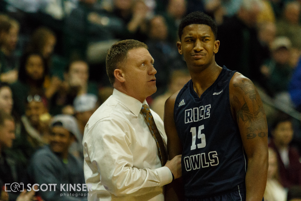 February 11, 2016: Rice Owls head coach Mike Rhoades talks with Rice Owls guard Bishop Mency (15) after he picks up a foul in the NCAA Basketball match-up between the Rice Owls and the UNC Charlotte 49er's at Holton Arena in Charlotte, NC. Scott Kinser/CSM