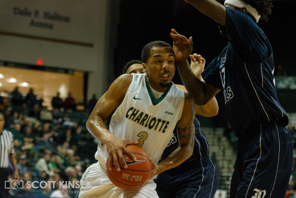 February 11, 2016: Charlotte 49ers guard Jon Davis (3) drives into Rice Owls forward Marquez Letcher-Ellis (12) in the NCAA Basketball match-up between the Rice Owls and the UNC Charlotte 49er's at Holton Arena in Charlotte, NC. Scott Kinser/CSM