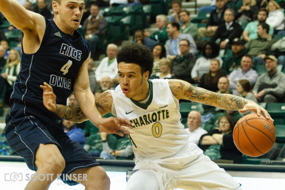 February 11, 2016: Charlotte 49ers guard Ridell Camidge (0) drives down on Rice Owls guard Egor Koulechov (4) in the NCAA Basketball match-up between the Rice Owls and the UNC Charlotte 49er's at Holton Arena in Charlotte, NC. Scott Kinser/CSM