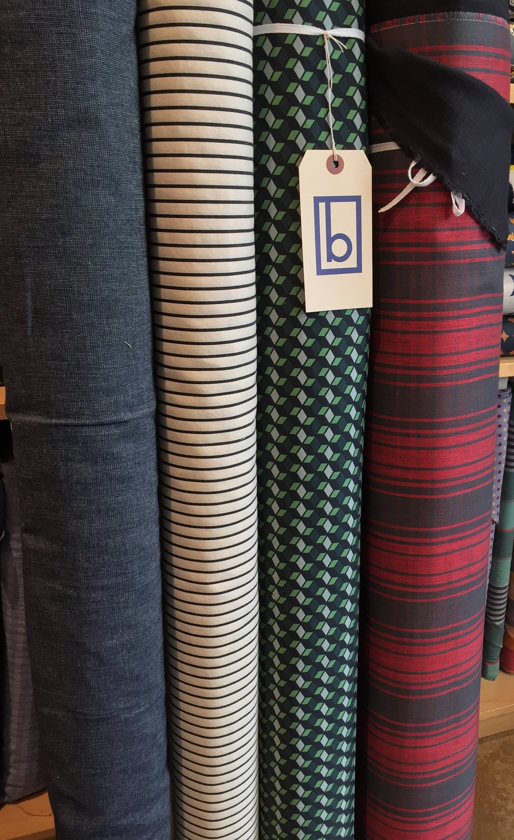 Interesting apparel goods! Plain weave cotton denim, mid weight cotton stripe, cotton/spandex bottom weight with 3D block design, and double sided cotton plaid.