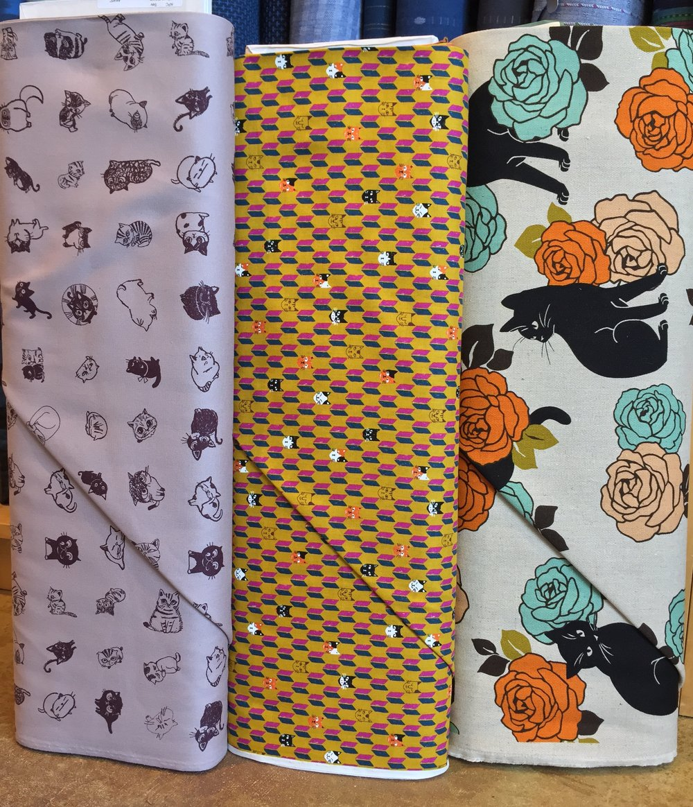 Kitty cat prints! Currently enamored with the black kitties on herringbone natural linen blend with the orange and aqua roses....