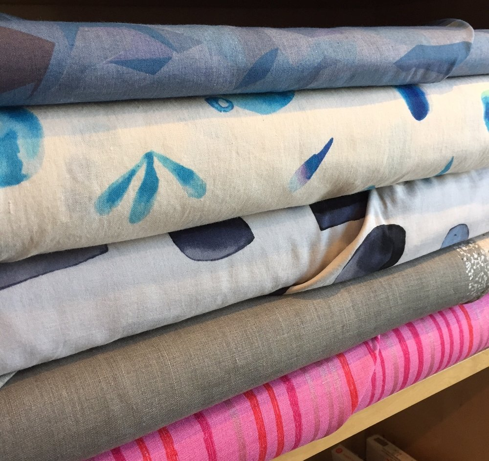 Top to bottom - beautiful printed chambray, lightweight cotton prints from 3 Mins., and two cotton/linen blends from Nani Iro.