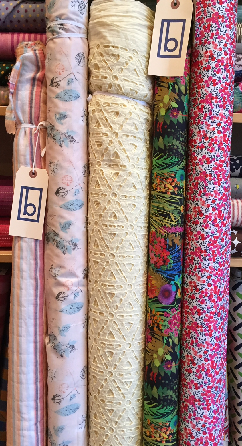 A variety of cottons, from super light weight stripe and softly colored cotton lawn on the far left, to a stretch cotton poplin from Liberty of London on the far right.