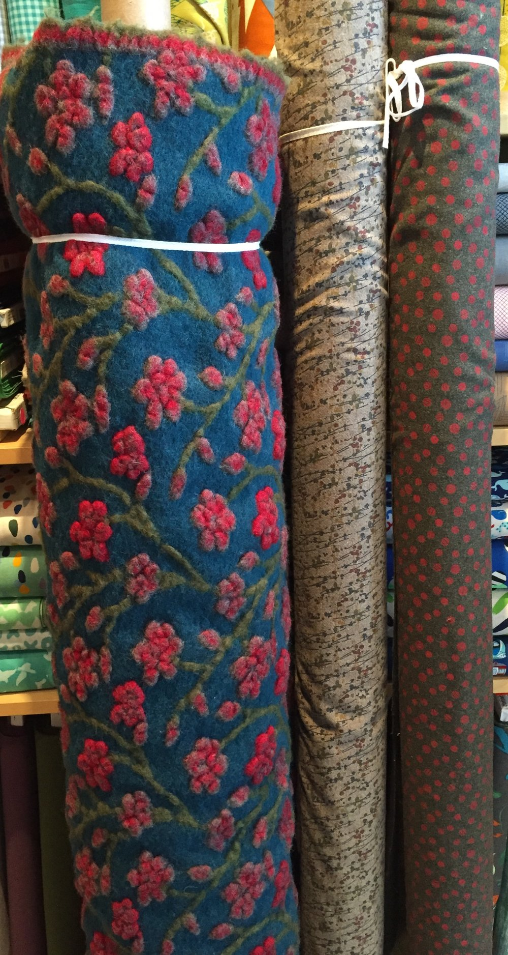 A very special boiled wool blossom design, and two printed lighter weight wools, a la Prada.
