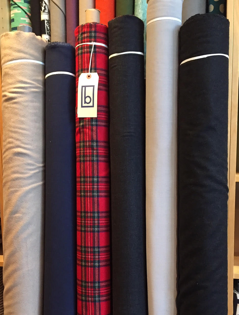 New wools! Left to right - camel Coating, Navy gauze, plaid coating, charcoal plaid suiting, grey gauze, and solid charcoal coating