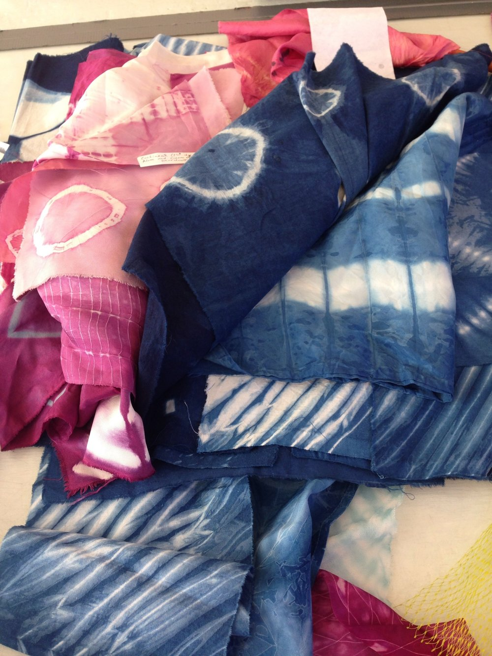 Samples dyed with indigo and cochineal from the Shibori scarf workshop