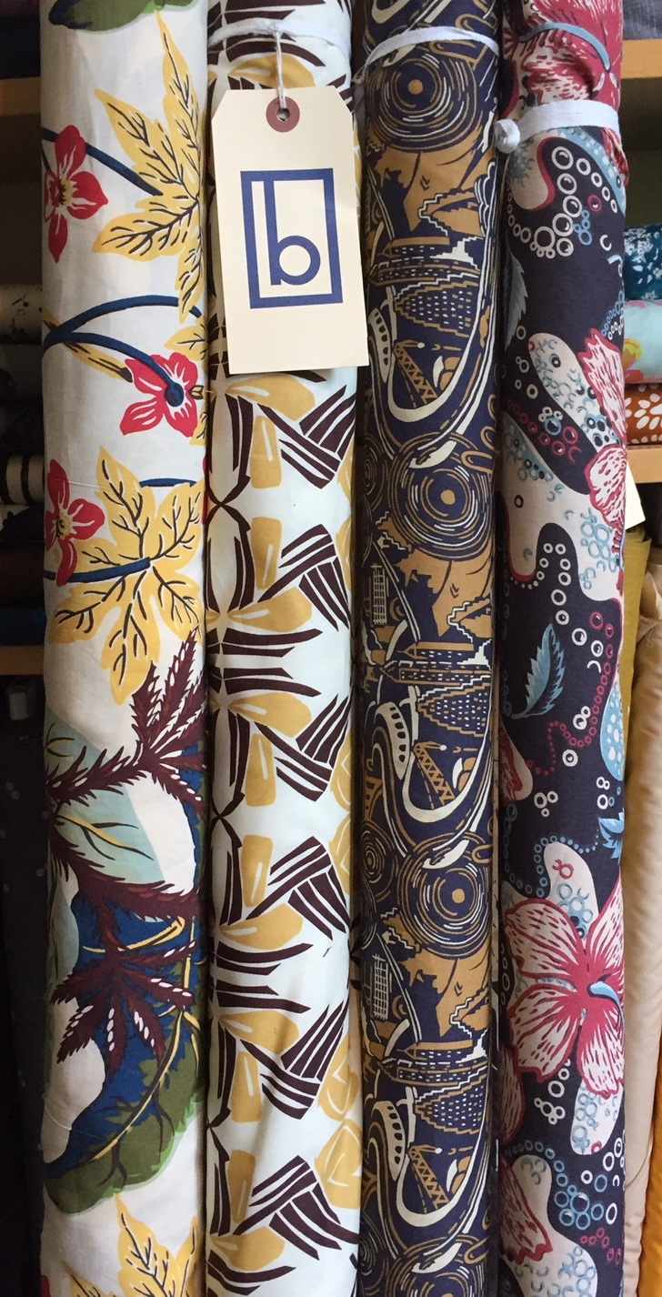 These mod-retro tropical prints from designer Reyn Spooner include two rayons on the right and two lusciously soft cottons on the left.