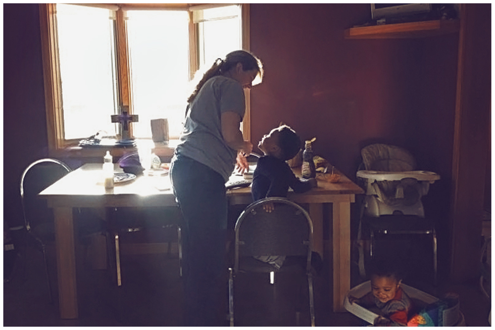 This is probably one of my favorite pictures of my mom. Taken from my cell phone catching her in her element also known as...Making Derrick pancakes :).