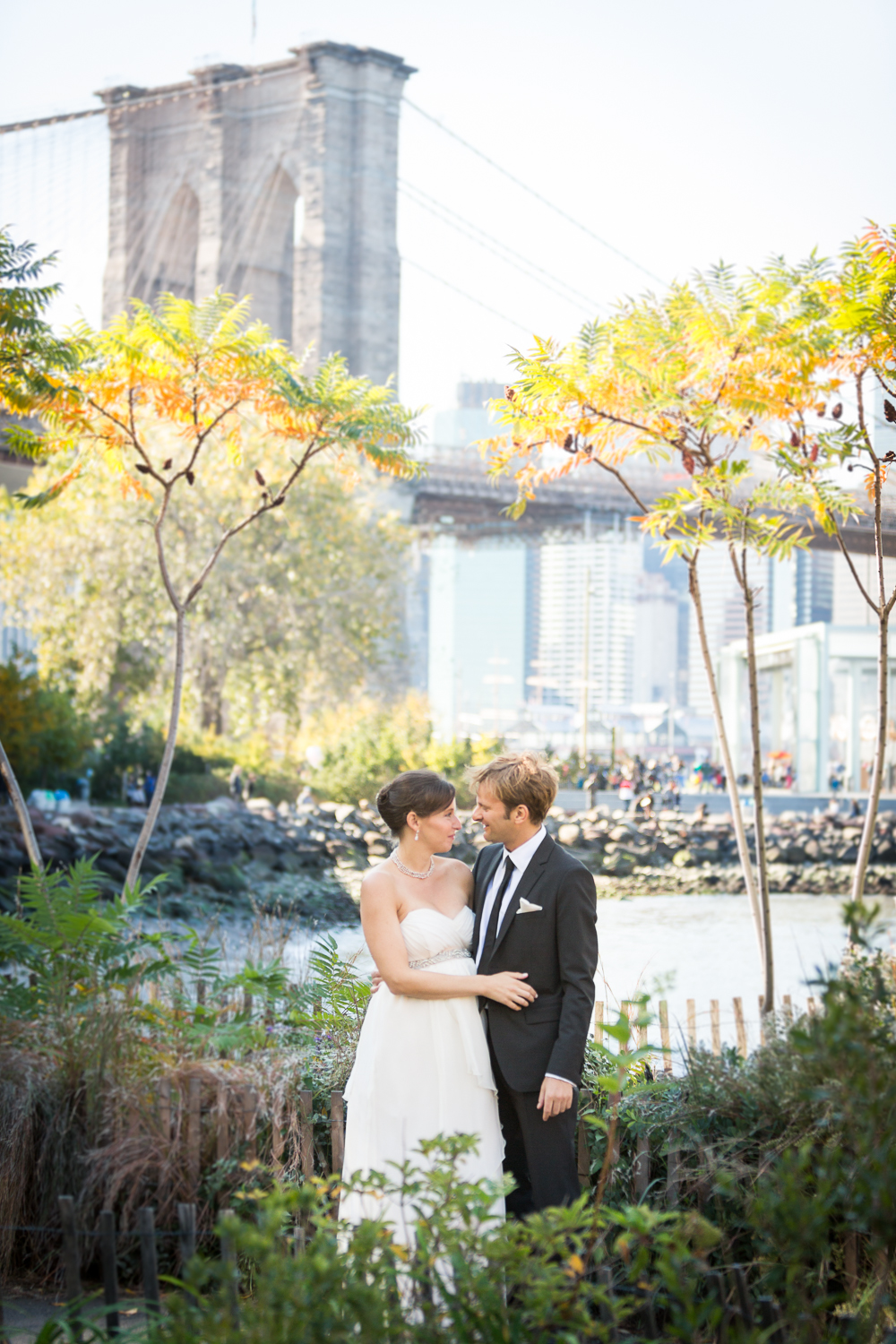 Wedding Photography in Brooklyn by Julie Saad. Traditional wedding portrait in DUMBO, near the Brooklyn Bridge.