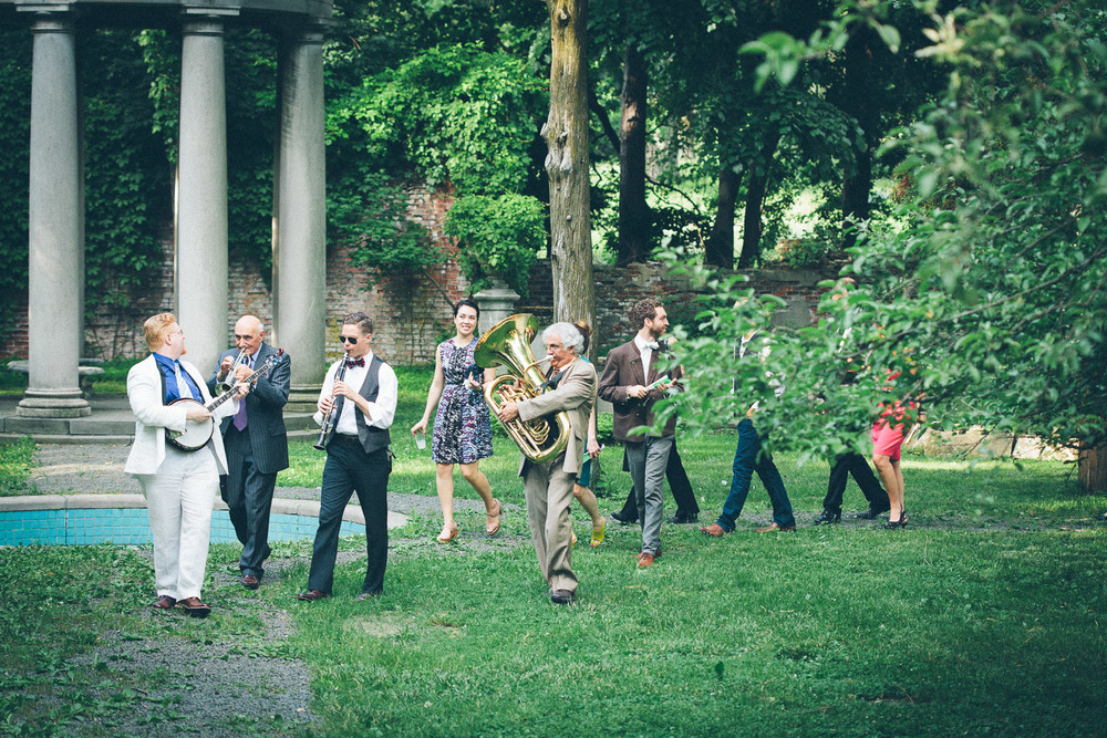 The wedding band marches out after the end of the wedding. Featuring a banjo, a clarinet and a tuba! I love it!