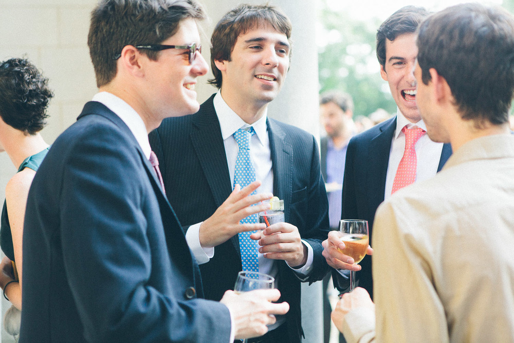 Male guests at wedding reception laughing. Alder Manor, Yonkers, NY.