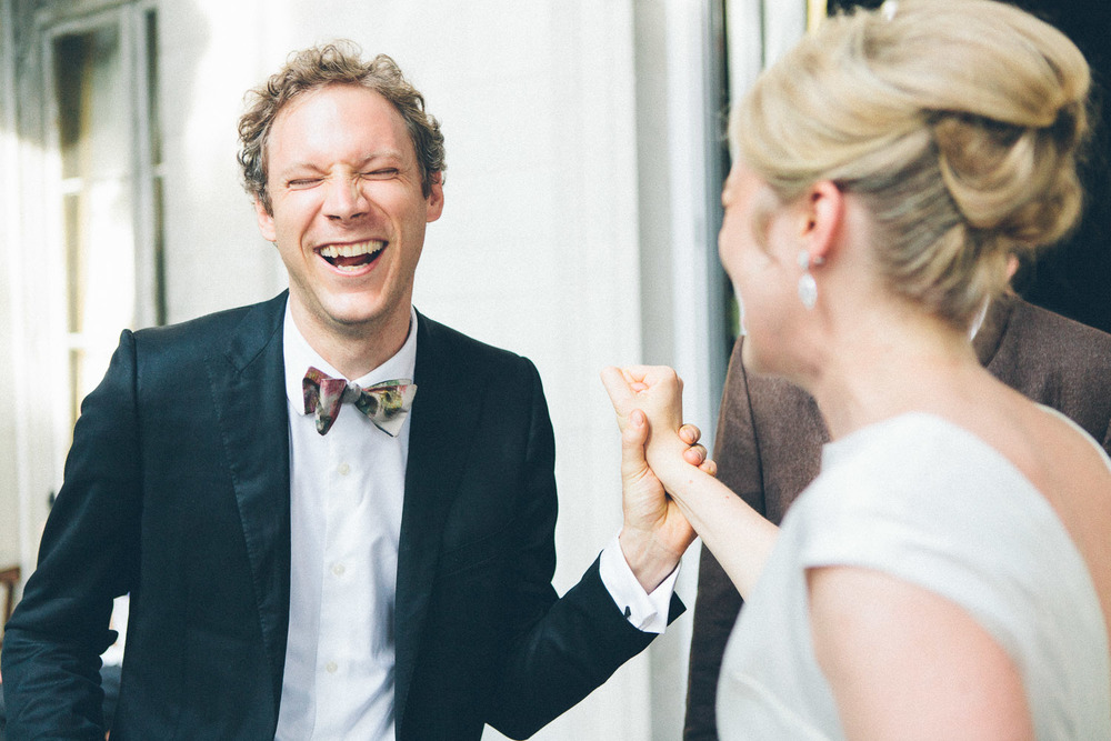 Our beautiful bride laughing with one of her guests. Things I love: her sleek and chic undo, his multi-colored bow tie. A wonderful summer wedding at Alder Manor, Yonkers, NY.