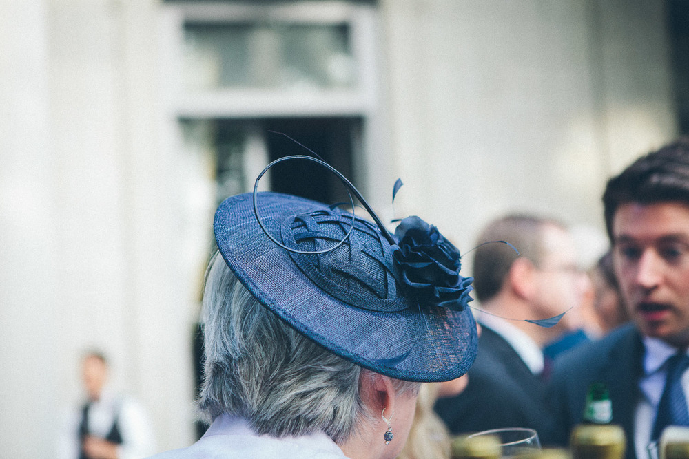 Somewhere between a hat and a fascinator. I adore this navy blue headpiece!