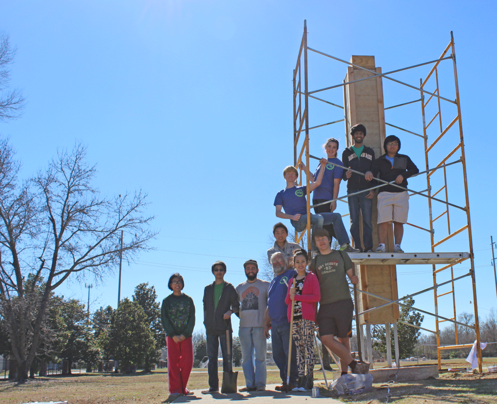 The MSMS SEAL team stand next to their nearly completed chimney swift tower. Today's completion marks the end of two years worth of work for the students.