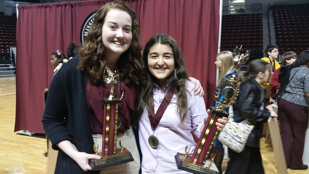 MSMS Senior Emoree Heiselt and Junior Aylin Memili hold their winning trophies.