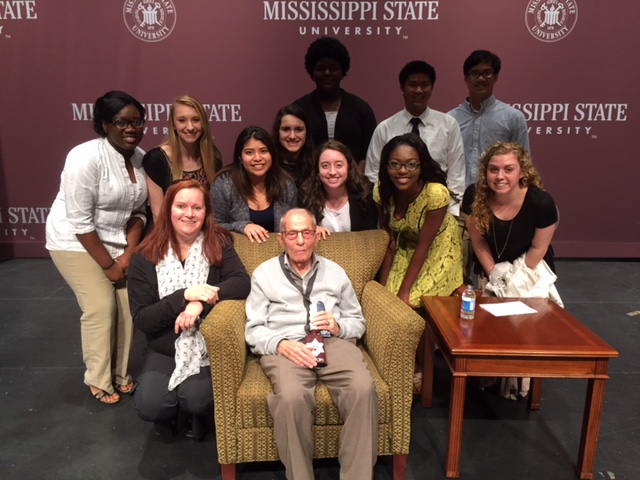 Holocaust survivor, Bob Behr, with MSMS faculty member, Julie Heintz, and some of the MSMS students who attended the lecture.
