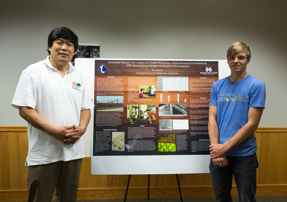 MSMS senior and Stone County native Ross Berry (right) stands next to his award winning project with his mentor Dr. Hui Wan of Mississippi State University's Department of Sustainable Bioproducts.