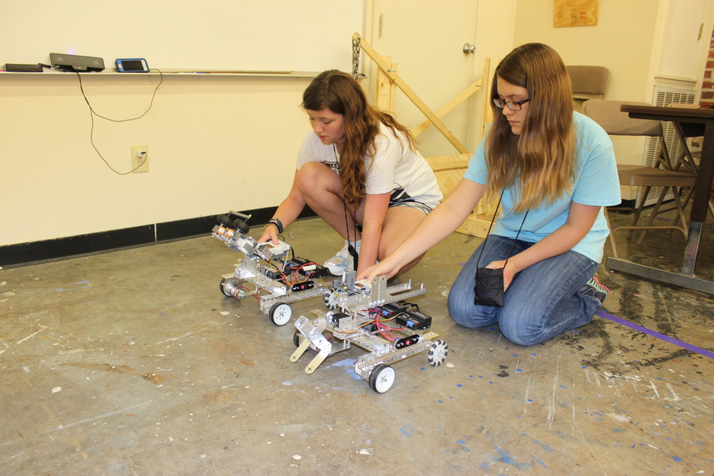 MSMS campers working on their robots rely on the ideals of Scholarship and Creativity.