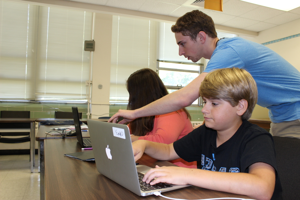 MSMS Camp Counselor Michael McDonald helps the campers with their Convergent Media projects.