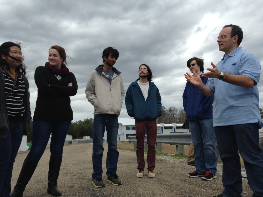 Figure 1: MSMS Modern Physics students visit the LIGO observatory in Livingston, LA in the Spring of 2015, only a few months before the discovery of the binary black hole gravitational wave signal observed by the LIGO collaboration.  They are standing here directly above the 4 km interferometer tunnel.