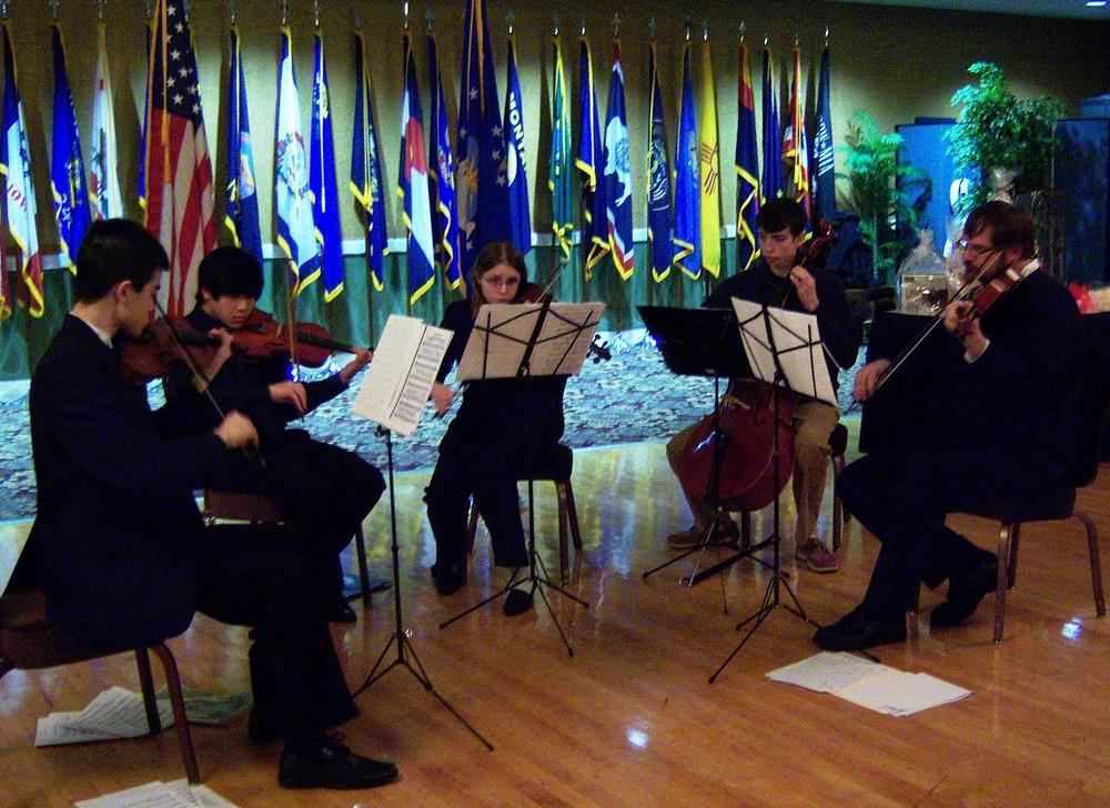 MSMS Strings Club students and sponsor perform Mozart K.157 and K.525 in April 2010 at the Columbus Air Force Base Officer's Formal for the base commander.