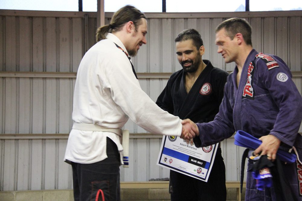 Adam Mansfield is promoted by coaches Adam Newton and Thiago Stefanutti
