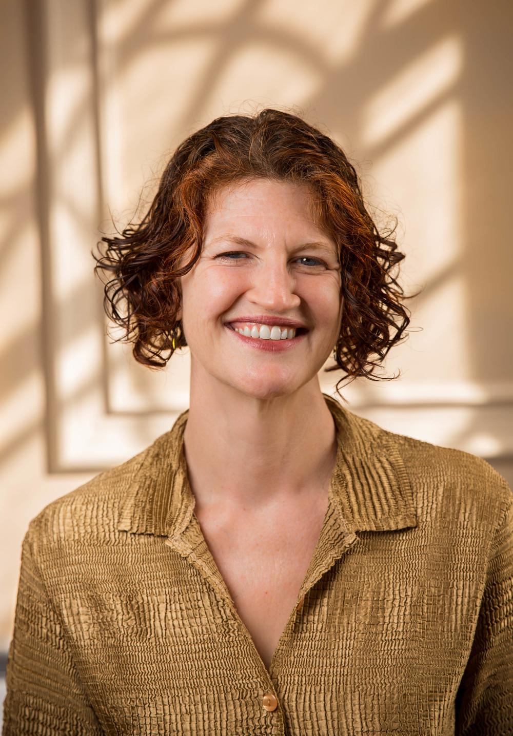 JocelynSwigger color smiling headshot.jpg